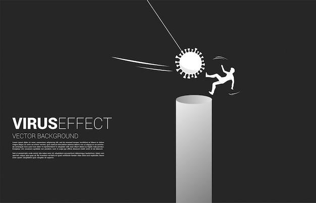 Силуэт бизнесмен падает от вирусной атаки короны. бизнес-концепция разрушения бизнеса и эффекта домино от пандемии.