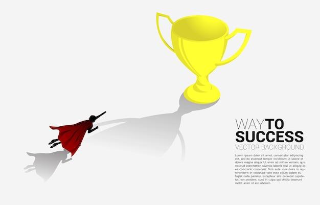 ビジネスマンのシルエットはトロフィーに飛ぶ。ブーストとビジネスの前進の概念。