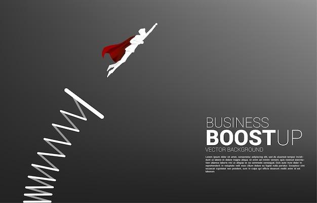 발판에서 비행하는 사업가의 실루엣입니다. 사업 부스트와 성장의 기치.