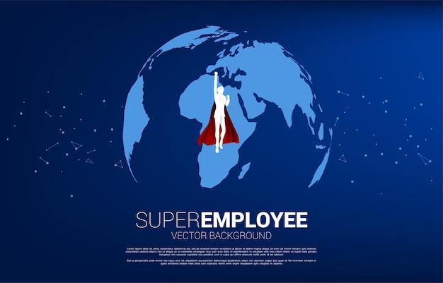 세계 세계에서 비행 하는 사업가의 실루엣입니다. 세계 목표 임무의 비즈니스 개념입니다.