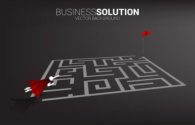 ゴールに迷路の上を飛んでいるビジネスマンのシルエット。問題解決とアイデアを見つけるためのビジネスコンセプト。