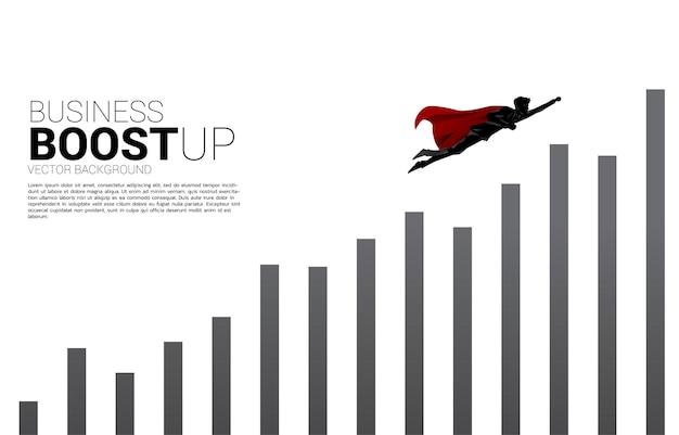 그래프의 더 높은 열로 날아가는 사업가의 실루엣입니다. 비즈니스의 부스트와 성장의 개념입니다.