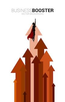 화살표로 더 높이 날아가는 사업가의 실루엣. 비즈니스의 부스트와 성장의 개념입니다.
