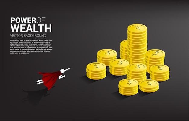 동전 더미 위로 날아가는 사업가의 실루엣. 성공 투자 및 비즈니스 성장의 개념