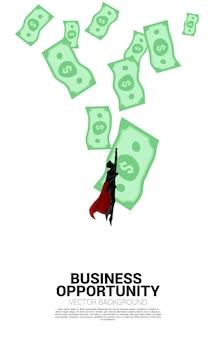 위에서 돈 방울과 함께 비행 하는 사업가의 실루엣. 성공 투자 및 비즈니스 성장의 개념