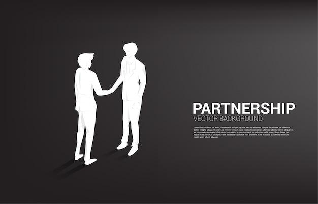 Силуэт бизнесмена рукопожатие. концепция совместной работы партнерства и сотрудничества.