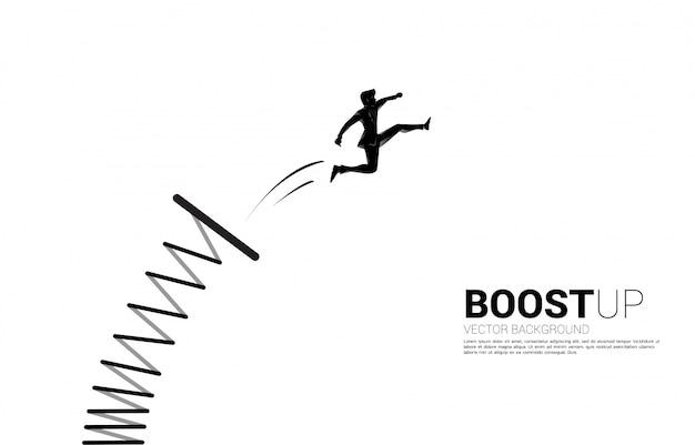 ビジネスマンのシルエットは踏み台で高くジャンプします。後押しとビジネスの成長の概念。