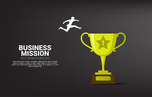 黄金のトロフィーにジャンプするビジネスマンのシルエット。キャリアパスにおけるビジネスリスクとチャレンジのコンセプト
