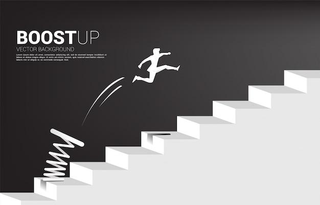 발판으로 단계를 통과하는 점프 사업가의 실루엣. 타겟팅 및 customer.route 성공의 비즈니스 개념입니다.
