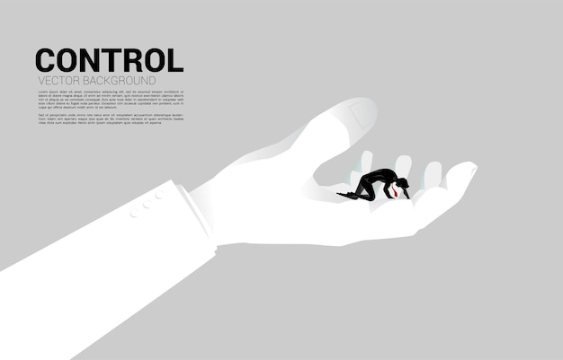 큰 손에 무릎에 사업가의 실루엣입니다. 직장 생활을 통제하는 개념.