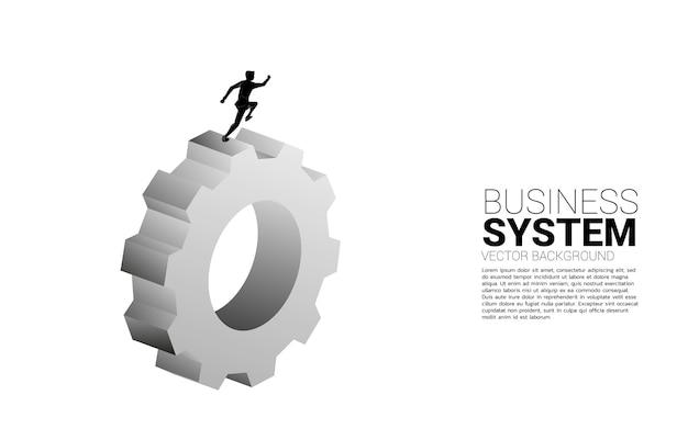 큰 장비에서 실행하는 사업가의 실루엣입니다. 비즈니스 관리 및 제어의 개념