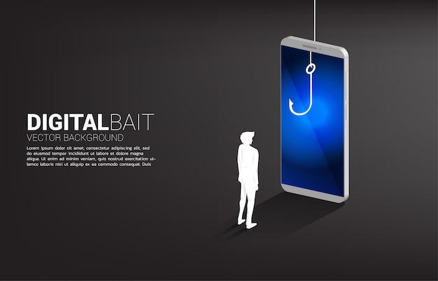 휴대 전화에서 낚시 훅으로 서 사업가의 실루엣. 디지털 사기 및 사기 사업의 개념입니다.