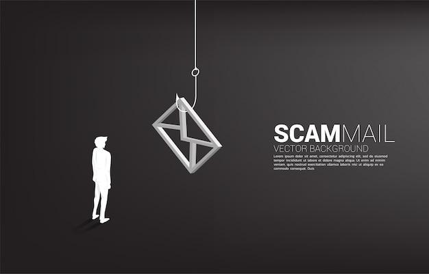 Силуэт бизнесмена стоя с рыболовным крючком с значком электронной почты. понятие мошеннической почты и фишинга.