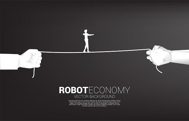 Силуэт бизнесмена ходьбы веревки в робота и человеческой руки