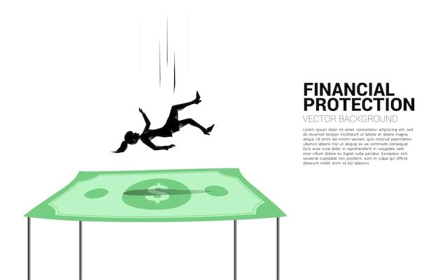 달러 지폐에 아래로 떨어지는 사업가 실루엣 보험 및 재정 보호에 대 한 개념