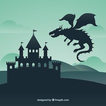 城と飛行龍のシルエット