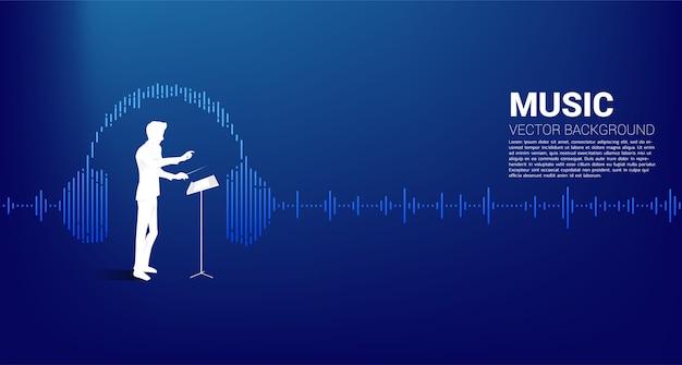 ヘッドフォン音楽イコライザーの背景で立っている指揮者のシルエット。クラシック音楽のコンサートやレクリエーションの概念の背景。