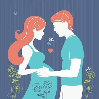 커플의 실루엣입니다. 임신한 여자와 그녀의 남편이 있는 배경