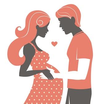 커플의 실루엣입니다. 임신한 여자와 그녀의 남편