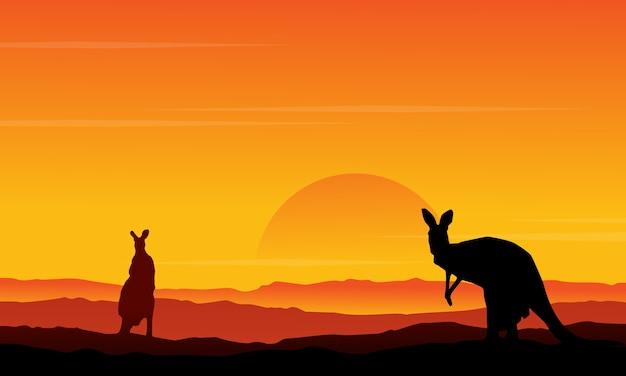 丘の景色のカンガルーのシルエット