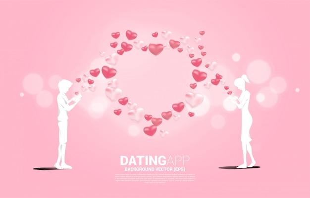 남자와 여자의 실루엣 여러 심장 입자와 휴대 전화를 사용합니다. 온라인 사랑과 데이트 응용 프로그램에 대한 개념.