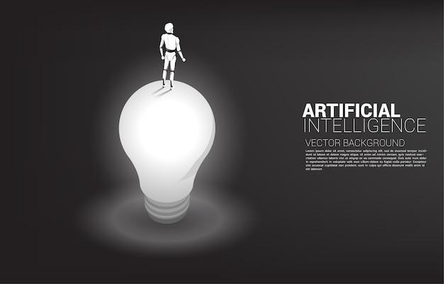 전구 위에 서있는 로봇의 실루엣. 인공 지능 투자의 개념.