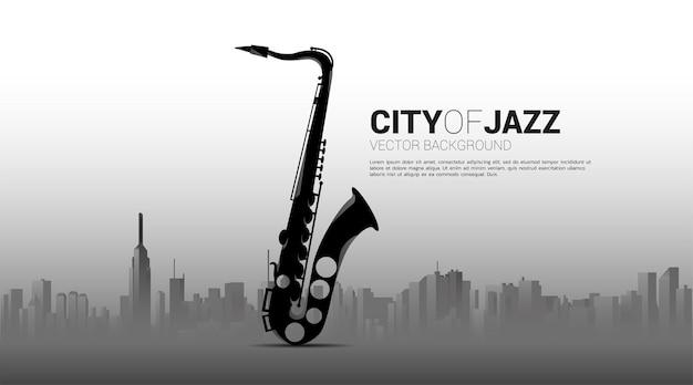 都市とサックスのシルエット。ジャズ音楽の街のバナー。