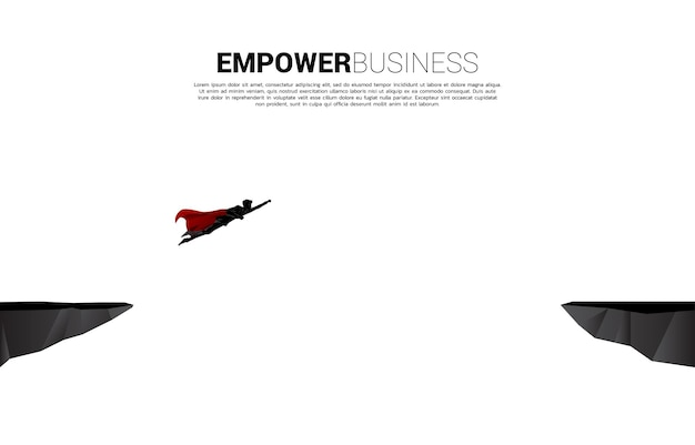 슈퍼 히어로의 실루엣은 심연을 가로질러 날아갑니다. 비즈니스 도전 및 권한 부여의 개념입니다.