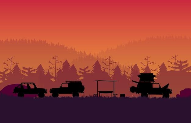 オレンジ色のグラデーションで森の山の風景とキャンプするオフロード車のシルエット