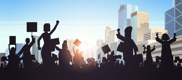 Silhouette of people crowd protesters holding protest posters men women with blank vote placards demonstration speech political freedom concept cityscape background horizontal portrait