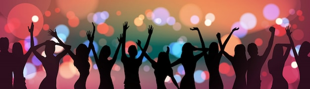 Silhouette people dancing over holiday firework background party celebration concept