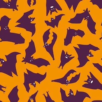 Silhouette of purple bats on an orange background