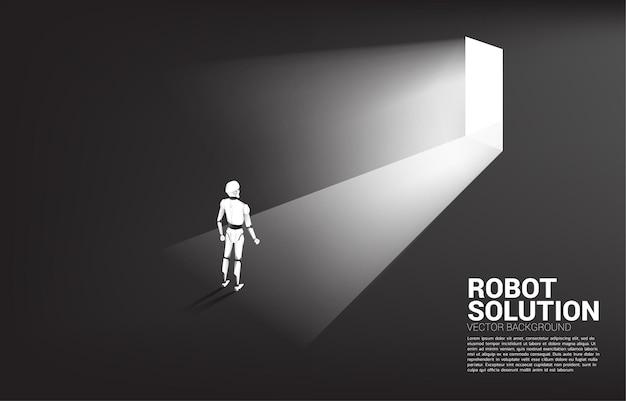 Silhouette of robot standing in front of exit door.
