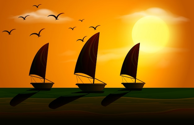 Silhouette scene with sailboats at sunset