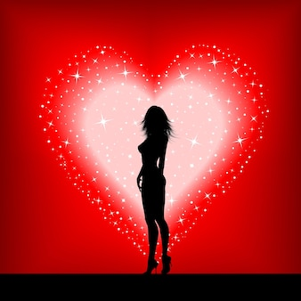 Silhouette of a sexy female on a starry heart background