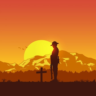 Silhouette of soldier paying respect at the grave,