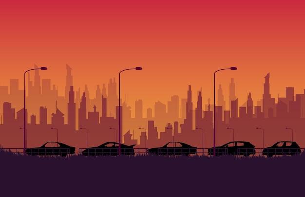 オレンジ色のグラデーションで街と道路上のシルエットストリートカーレース
