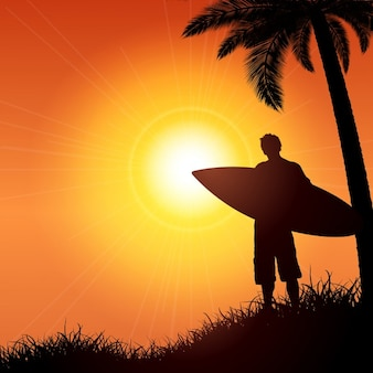 Silhouette of a surfer against a tropical background