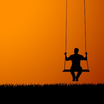 Silhouette on swing at sunset