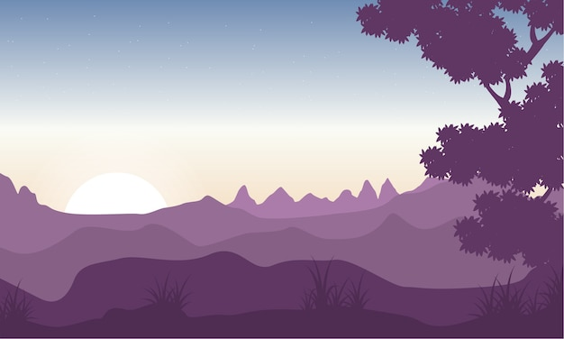 Silhouette of tree with mountain backgrounds