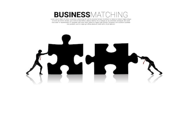 Silhouette of two businessman pushing two jigsaw pieces puzzle. concept of business teamwork.