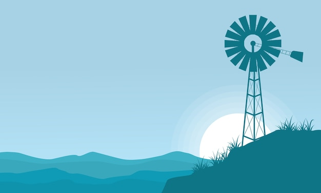Silhouette of windmill on the hill scenery
