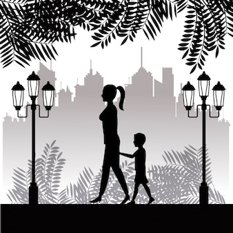 Silhouette woman and child walking park town background