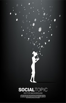 Silhouette of woman use mobile phone and hash tag flying . background concept for social topic and news.