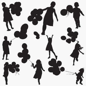 Silhouettes child holdings balloons
