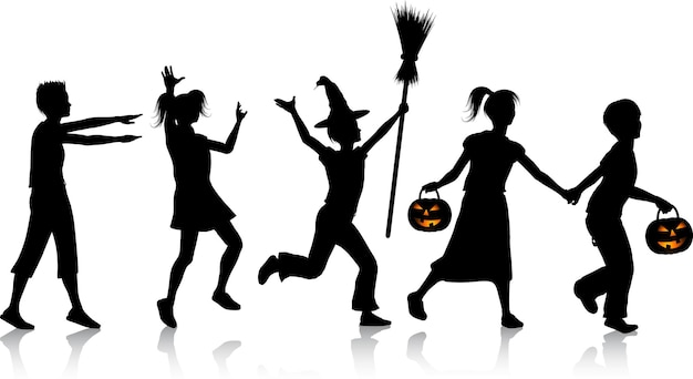 Silhouettes of children playing on halloween night