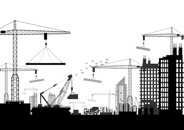 Silhouettes of cranes working on the building