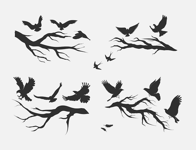 Silhouettes of flying birds mounted on branches