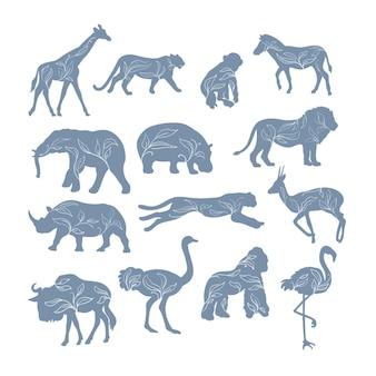 分離された装飾的な植物とアフリカの動物のシルエット