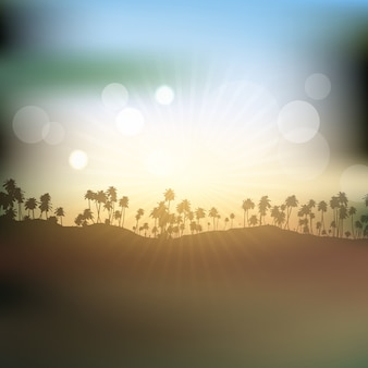 Silhouettes of palm trees against sunset sky